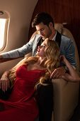 Beautiful Elegant Sexy Couple Sitting In Airplane poster