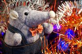 A Plush Mouse Next To Christmas Tinsel And Led Lights. A Symbol Of Wealth, Wealth And 2020 On The Ch poster