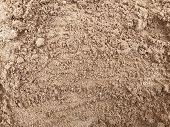 Brown, Wet Sand. The Texture Of Wet Brown Sand. Natural Texture. poster