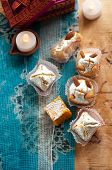 pic of mithai  - Diwali Sweets set in a Rustic India setting with rustic lamps and traditional Indian printed blue cloth - JPG