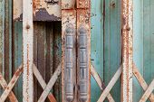 Old Steel Door, Old Blue Folding Metal Door Gate, Close-up Old Metallic Door,  Rusty Steel Door. poster