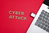 Cyber ​​attack Minimal Concept. Laptop With Flash Drive On A Red Background With Text Cyber Attack.  poster