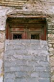 stock photo of oddities  - Bricked up vintage door and grungy wall - JPG