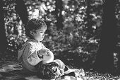 Boy Cute Child Play With Teddy Bear Toy Forest Background. Picnic With Teddy Bear. Hiking With Toy.  poster