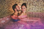 Happy Couple Having Fun In Swimming Pool Luxury Spa Resort Hotel - Romantic Young People Doing Relax poster