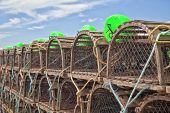 pic of lobster boat  - Lobster traps piled up on the wharf in rural Prince Edward Island - JPG