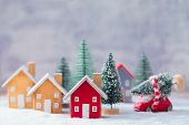 Miniature Wooden Houses Over Blurred Christmas Decoration Background, Property Real Estate Investmen poster