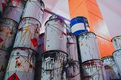 A Collection Of Paint Cans, Glue Buckets, Mastic And Toxic And Hazardous Material Stacked poster