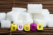 image of diabetes symptoms  - Sugar lumps and word sugar - JPG