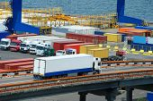 picture of trucks  - white truck transport container in port - JPG