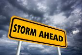 stock photo of collapse  - Storm ahead warning sign over gloomy sky - JPG