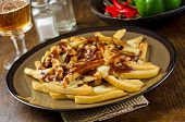 stock photo of curd  - A plate of Canadian poutine with french fries - JPG