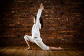 pic of pranayama  - Girl exercising yoga against brick wall - JPG