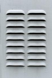 stock photo of louvers  - A gray metal ventilation louver with horizontal slats - JPG