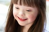 picture of playgroup  - Portrait of beautiful young girl smiling outside - JPG