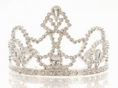 image of beauty pageant  - crown or tiara isolated on a white background with reflection - JPG