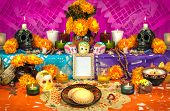 stock photo of mexican fiesta  - Traditional mexican Day of the dead altar with sugar skulls and candles - JPG