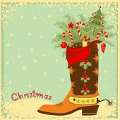 stock photo of cowboy  - Cowboy Christmas card with boot and winter holiday elements - JPG