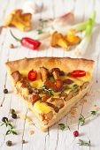 stock photo of chanterelle mushroom  - Delicious homemade pie with chanterelle mushrooms and vegetables - JPG