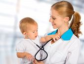 foto of diagnostic medical tool  - female doctor pediatrician and patient happy child baby - JPG