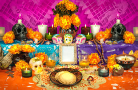 picture of sugar skulls  - Traditional mexican Day of the dead altar with sugar skulls and candles - JPG