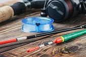 image of spinner  - fishing tackle on a wooden table - JPG