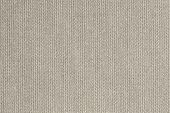 knitted woolen fabric of gray beige color