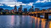 stock photo of portland oregon  - Colorful lights reflecting off the Willamette River in Downtown Portland Oregon - JPG