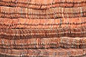 foto of red roof tile  - stack red roof tiles in Thailand temple - JPG