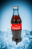 MOSCOW, RUSSIA-APRIL 4, 2014: Bottle of Coca-Cola on ice. Coca-Cola is a carbonated soft drink sold