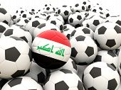 stock photo of iraq  - Football with flag of iraq in front of regular balls - JPG