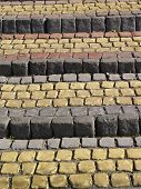 image of pavestone  - Old stone pavement stairs from bricks background - JPG