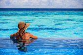 stock photo of beach hat  - Relaxing on beach resort - JPG