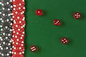 Gambling chips and dice  on the green background