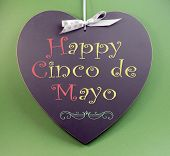 foto of mexican fiesta  - Happy Cinco de Mayo 5th May event reminder handwriting greeting on heart shaped blackboard with sample text on green background - JPG