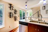 stock photo of dishwasher  - View of kitchen cabinet dishwasher wine holder on the wall - JPG