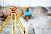 stock photo of theodolite  - Surveyor equipment optical level or theodolite outdoors at construction site - JPG