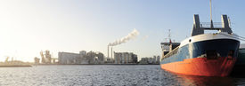 stock photo of tatas  - Panoramic view of tanker and power plant in Amsterdam harbor  - JPG