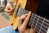 stock photo of diffusion  - Hand and guitar of a playere diffusing sound - JPG