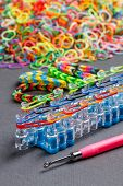 foto of loom  - Band loom and colorful elastic bands - JPG