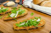 pic of crust  - Fried eggplant fried in parmesan crust arugula salad with shavings of Parmesan cheese fresh bread  - JPG