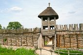 image of stockade  - Palisade and entrance into the old archaeological settlement in Biskupin Poland - JPG