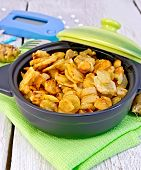 picture of jerusalem artichokes  - Jerusalem artichokes roasted in a roasting pan with a lid fresh tubers on a napkin the meter and pills on a white background wooden plank - JPG