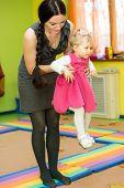 pic of montessori school  - Mother and child girl playing in kindergarten in Montessori preschool Class - JPG