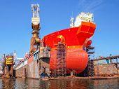 stock photo of shipbuilding  - Ship bow forward on dry dock industrial shipyard - JPG