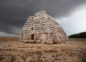 stock photo of megaliths  - Naveta des Tudons funerary megalithic monument in Menorca Spain - JPG