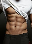 Постер, плакат: Closeup Photo Of An Athletic Guy With Perfect Abs