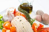 foto of raw chicken sausage  - Baked chicken stuffed with fresh raw vegetables - JPG