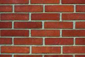 pic of mortar-joint  - Wall made of orange  brick with white joints - JPG