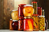 image of pickled vegetables  - Jars with pickled vegetables fruity compotes and jams in cellar. Preserved food